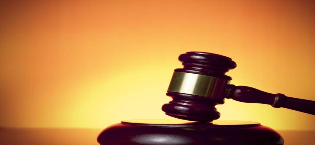 MINTZ & GEFTIC - Gavel with orange and yellow background - representing settlement for Accident Injury Lawyers Elizabeth, NJ