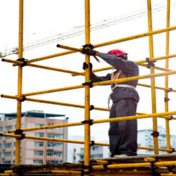 construction workers in city working on scaffolding